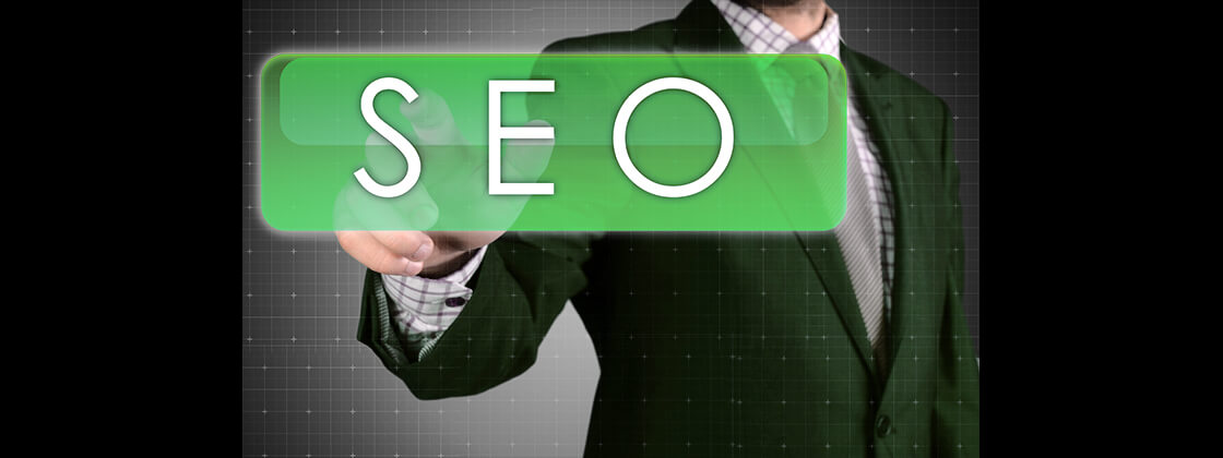 Businessman Pressing SEO button